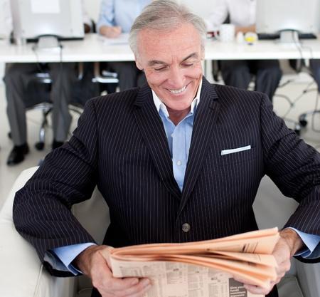 Senior businessman reading a newspaper photo
