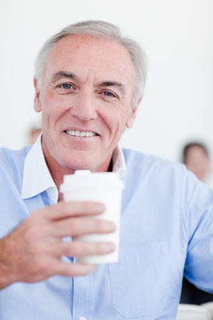 Senior businessman drinking a tea photo