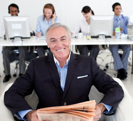 Senior manager reading a newspaper  photo