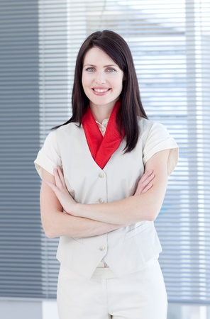 Portrait of an attractive businesswoman with folded arms photo