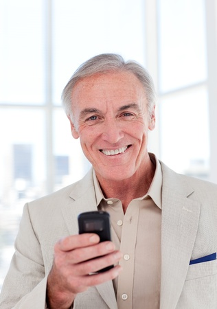 Senior businessman using a mobile phone photo