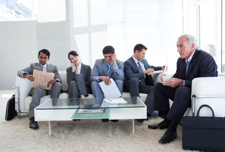caucasian ethnicity: Business people sitting and waiting for a job interview