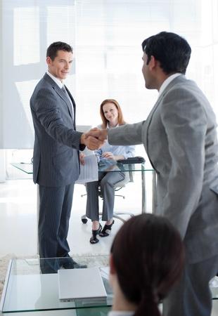 Multi-ethnic businessmen shaking hands photo