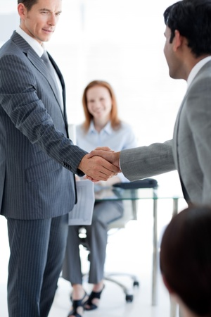 Businessmen greeting each other at a job interview photo
