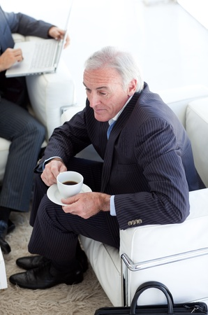 Businessman drinking coffee and waiting for a job interview Stock Photo - 10094122