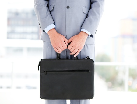 Mysterious businessman holding a briefcase photo