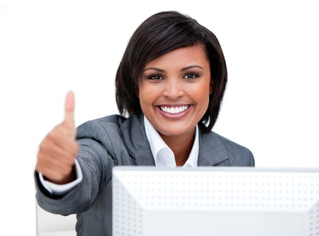 Confident businesswoman working at a computer  photo