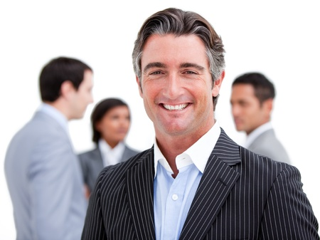 Charming businessman working at a computer  photo