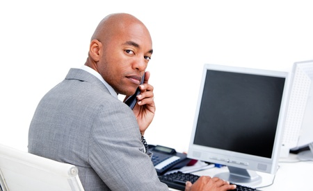 Positive businessman on phone at his desk  photo