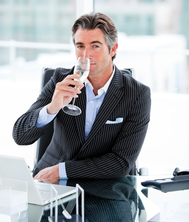 Confident businessman drinking a glass of water Stock Photo - 10093734