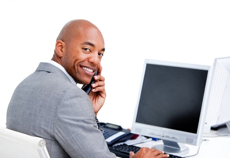 Cute businessman on phone at his desk  photo