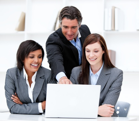 Multi-ethnic business team working at a computer Stock Photo - 10093395