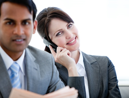 businessman waiting call: Confident businesswoman on phone sitting on a sofa Stock Photo