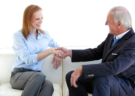Young business people shaking hands in agreement  photo