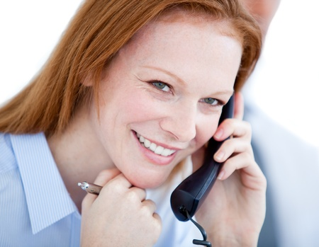 Positive businesswoman taling on phone photo