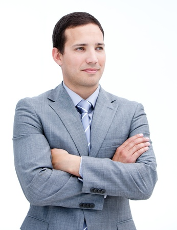Portrait of a handsome businessman with folded arms standing photo