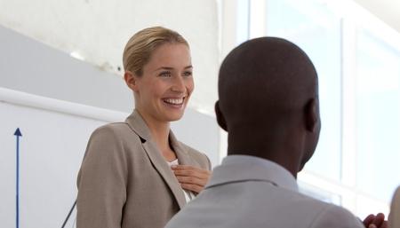 Successful businesswoman doing a presentation  photo