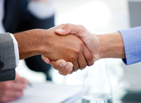 Close-up of business partners shaking hands photo