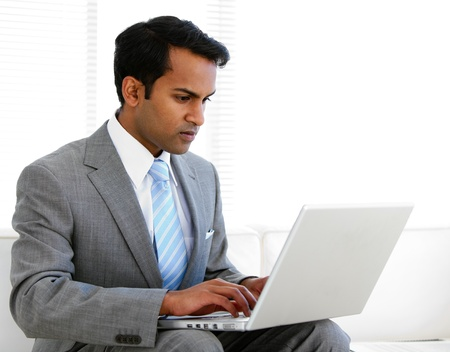 Self-assured businessman working on his computer  photo