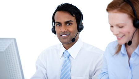 Confident business group in a line working at computers Stock Photo - 10078228