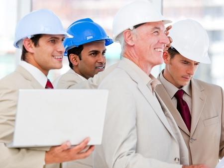 originator: Condifent architect team working on a building project