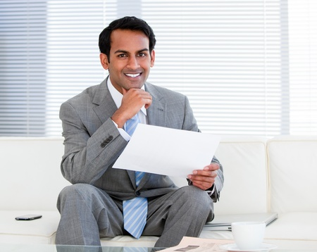 Smiling businessman holding a note photo