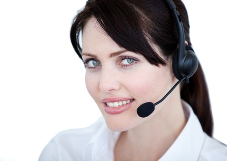 Glowing businesswoman with headset on  photo