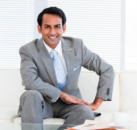 animated adult: Handsome businessman sitting on the sofa Stock Photo
