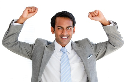 indian business man: Jolly businessman punching the air in celebration  Stock Photo