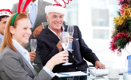 Businessman team celebrating christmas  Stock Photo - 10093215