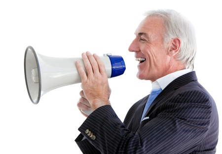 Businessman giving instructions with a megaphone  photo