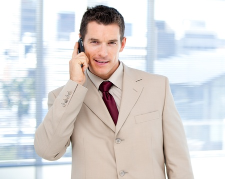 assertive: Assertive businessman talking on phone standing  Stock Photo