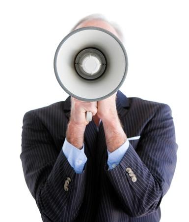 businessman using a megaphone: Senior businessman using a megaphone