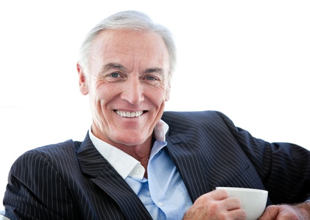 attractive charismatic: Confident senior businessman drinking a coffee