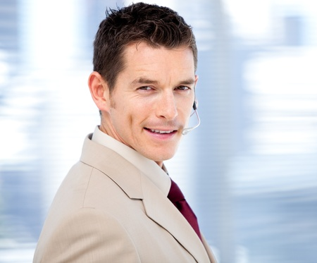 Confident businessman with headset on standing  Stock Photo - 10078445