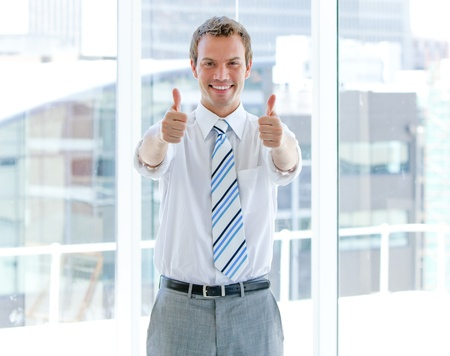 male's thumb: Portrait of a successful businessman with thumbs up Stock Photo