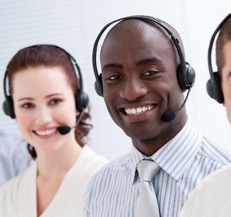 Happy customer service representatives standing in a line Stock Photo - 10076083