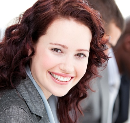 charismatic: Close-up of a buinesswoman smiling at the camera in a meeting