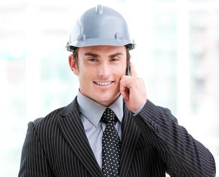 originator: Portrait of a confident male architect on phone