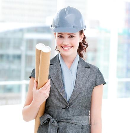 originator: Portrait of a self-assured female architect holding blueprints Stock Photo