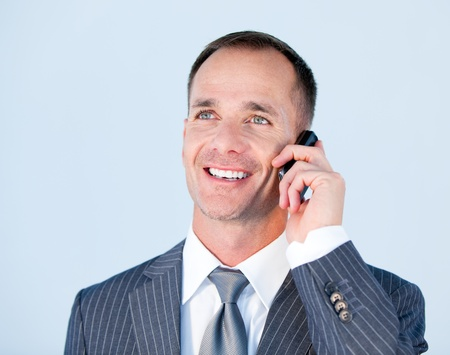 Handsome businessman talking to the phone photo