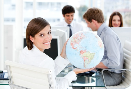 animated adult: Confident businesswoman holding a globe