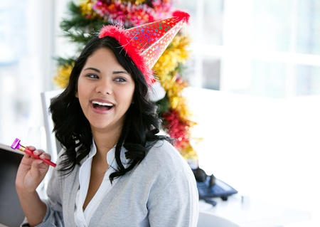 Positive businesswoman celebrating christmas Stock Photo - 10093040