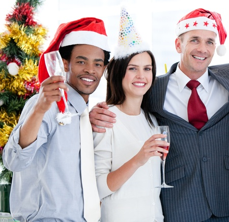 United business team drinking champagne to celebrate christmas Stock Photo - 10093516