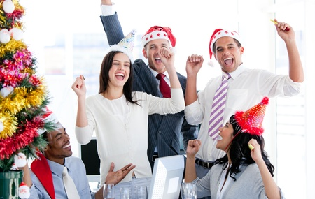 Business team punching the air to celebrate christmas  Stock Photo - 10093771