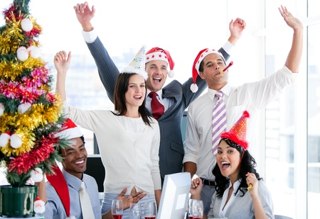 Nice business team punching the air to celebrate christmas Stock Photo - 10094104