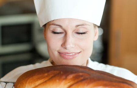 home baked: Radiant female chef baking bread  Stock Photo