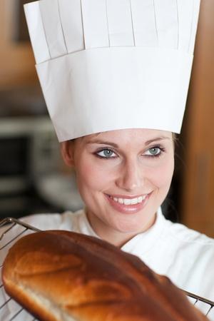 Confident female chef baking bread  photo