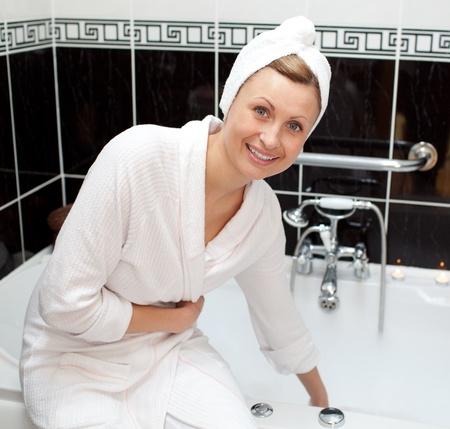 bathtowel: Smiling young woman preparing her bubble bath