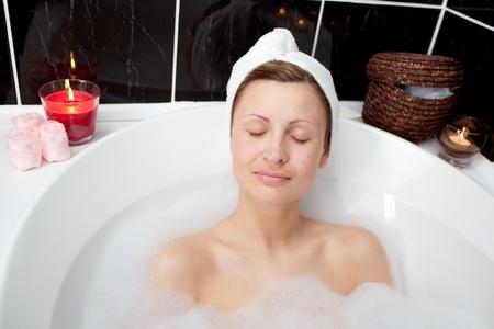 Beautiful woman relaxing in a bubble bath  photo